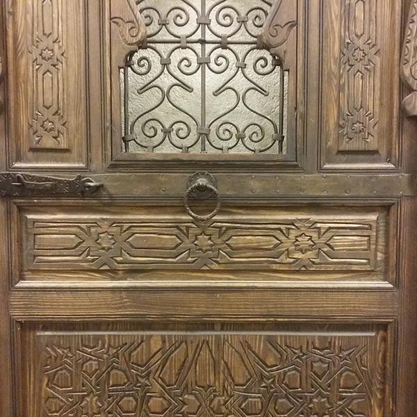 Porte bois fer forgée un vanteau